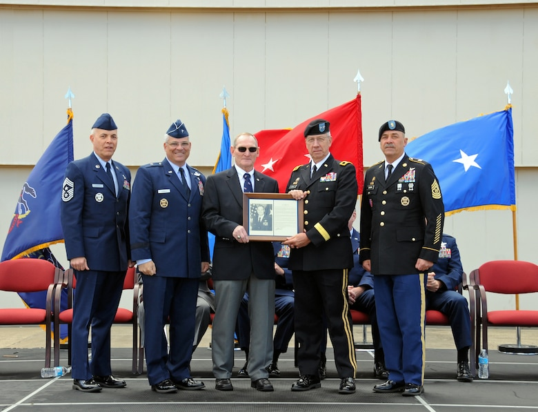 Brigadier General (Retired) William Boardley, center, receives his Pa Air National Guard Hall of Fame plaque from Major General Wesley Craig Pa National Guard Adjutant General at the annual Flight of Freedom ceremony held on Sunday, Sept 16th.  (Pa Air National Guard photo by Master Sgt. Chris Botzum)