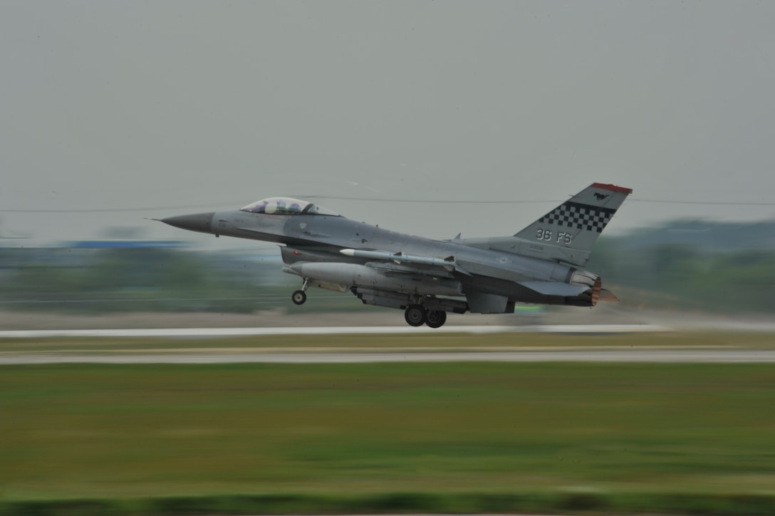 An F-16 Fighting Falcon from the 36th Fighter Squadron takes off from the runway in a mass launch during the operational readiness exercise Beverly Midnight 14-4 Sept. 17, 2014, at Osan Air Base, Republic of Korea. The jets flown during the mass launch are the A-10 Thunderbolt II, F-15 Eagle and F-16 Fighting Falcon. (U.S. Air Force photo by Senior Airman David Owsianka)