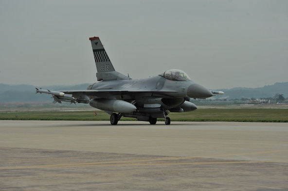 An F-16 Fighting Falcon from the 36th Fighter Squadron taxi's down the runway in a mass launch during the operational readiness exercise Beverly Midnight 14-4 Sept. 17, 2014, at Osan Air Base, Republic of Korea. A total of 38 jets were launched during the mass launch. (U.S. Air Force photo by Senior Airman David Owsianka)