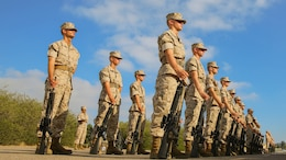 Recruits of India Company, 3rd Recruit Training Battalion, stand at parade rest as they await the senior drill Instructor's inspection at Marine Corps Recruit Depot San Diego, Sept. 5. During the inspection it was crucial for the recruits to remain calm, keep their eyes forward while at attention and answer the questions they were asked. It was a sign of confidence and bearing - two traits drill instructors were seeking.