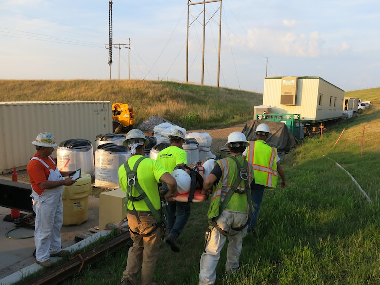 Each crew member was given a duty they are responsible for performing during the rescue drill. One employee is to call 911 and drive to the stop sign at the end of the road. This employee then waits for emergency personnel and assists with directing them into the jobsite.
