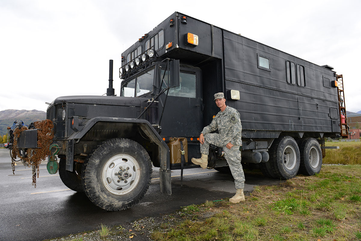 2 car garage conversion ideas - Army mechanic builds monster RV on military surplus