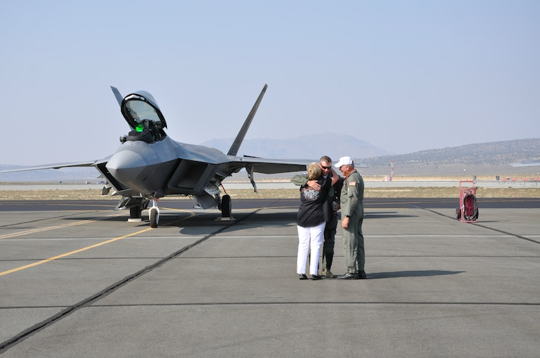 Lt. Col. Kevin Sutterfield is met by his parents Stan and Pat after landing his F-22 at Reno Sept. 9. Both Sutterfield and his father, Stan, competed in the 51st Annual National Air Races Sept. 10-14.  (U.S. Air Force/Maj. Ashley Conner)