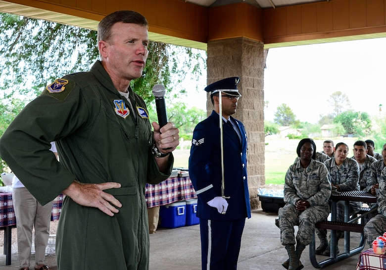 Lt. Gen. Tod Wolters, 12th Air Force (Air Forces Southern) commander, speaks to the members of 12th AF (AFSOUTH) wishing them all a happy birthday during the 12th AF (AFSOUTH)'s 67th Air Force Birthday at Davis-Monthan AFB, Ariz., Sept. 18, 2014.  Founded on Sept. 18, 1947, President Harry S. Truman signed the National Security Act that not only established a new defense organization but also established the U.S. Air Force as an independent service.  Over the past 67 years the U.S. Air Force has made its mark in history and around the world as it focuses its efforts on maintaining air, space, and cyberspace superiority.  (U.S. Air Force photo by Tech. Sgt. Heather R. Redman/Released)