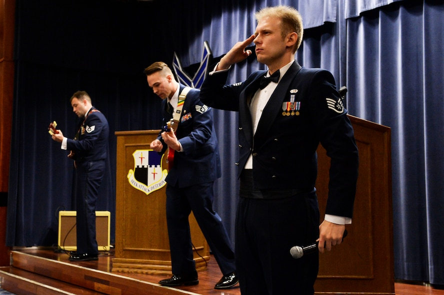 U.S. Air Force Staff Sgt. Joe W. McFadden, 52nd Fighter Wing Public Affairs, right, Staff Sgt. Kyle DeMarco, 52nd Medical Support Squadron, center, and Staff Sgt. Robbie Arp, 52nd FW Public Affairs, left, finish a song during the Air Force Ball at Club Eifel at Spangdahlem Air Base, Germany, Sept. 13, 2014. The Air Force Ball marked the 67th anniversary of the Air Force as its own military branch. (U.S. Air Force photo by Airman 1st Class Timothy Kim/Released)