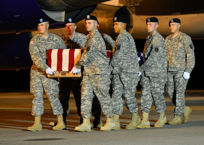 A U.S. Army carry team transfers the remains of Army Maj. Michael J. Donahue of Columbus, Ohio, Sept. 17, 2014, at Dover Air Force Base, Del. Donahue was assigned to the Headquarters and Headquarters Battalion, XVII Airborne Corps, Fort Bragg, N.C. (U.S. Air Force photo/Airman 1st Class William Johnson)