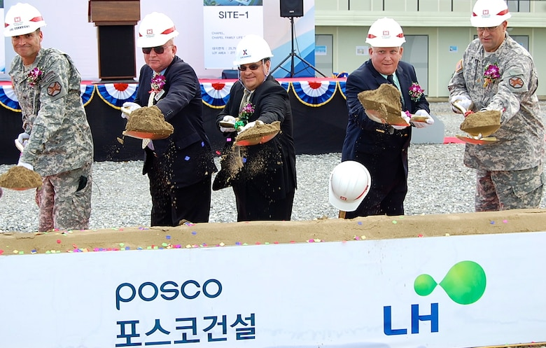 """Ground was broken for the new """"downtown"""" area, featuring a new Exchange, commissary and bowling center among other facilities, at Camp Humphreys, Aug. 11, 2014. The project will also see the construction of an auditorium, chapel, chapel family life center, an arts & crafts center, recreation center, plaza and parking. When completed, these facilities will provide retail shopping, groceries, entertainment, recreation and religious services."""
