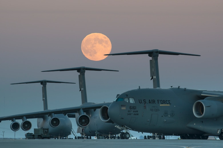 The 'supermoon' rises over the flightline Sept. 8, 2014, at Travis Air force Base, Calif.  Supermoons are full moons that coincide with 'lunar perigee,' when the moon's orbit brings it closest to Earth. (U.S. Air Force photo/Heide Couch)