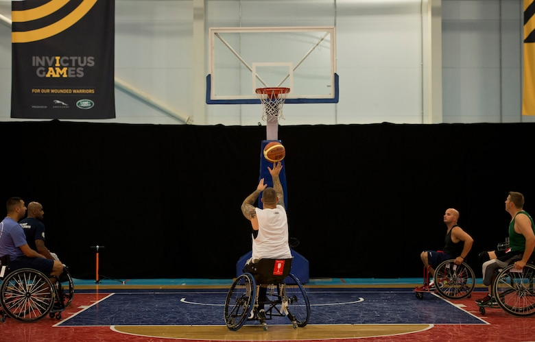 Steven Davis shoots a free throw during wheelchair basketball practice Sept. 8, 2014, at the Mayesbrook Field Sport House in London. Davis is a member of the U.S. wheelchair basketball team for the inaugural 2014 Invictus Games. Davis is a retired Navy aviation electrician's mate. (U.S. Air Force photo/Staff Sgt. Andrew Lee)