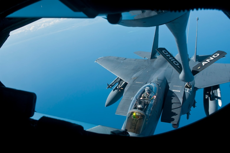 Members of the 121st Air Refueling Wing refuel an F-15E Strike Eagle using a KC-135A Stratotanker Sept. 11, 2014, off the coast of North Carolina during an exercise. The 121st ARW is from the Rickenbacker Air National Guard Base, Ohio. (U.S. Air National Guard photo/Airman 1st Class Wendy Kuhn)