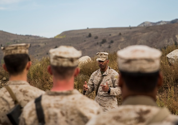 U.S. Marine Lt. Col. Wilfred Rivera congratulates his Marines after completing Mountain Exercise 2014 aboard Marine Corps Mountain Warfare Training Center in Bridgeport, Calif., Sept. 8, 2014. Rivera is the commanding officer for CLB-15. The training ensures the Marines are prepared to operate in mountainous terrain if the need arises while deployed with the 15th Marine Expeditionary Unit. Marines with 3rd Battalion, 1st Marine Regiment will become the 15th MEU's ground combat element in October. (U.S. Marine Corps photo by Sgt. Emmanuel Ramos/Released)