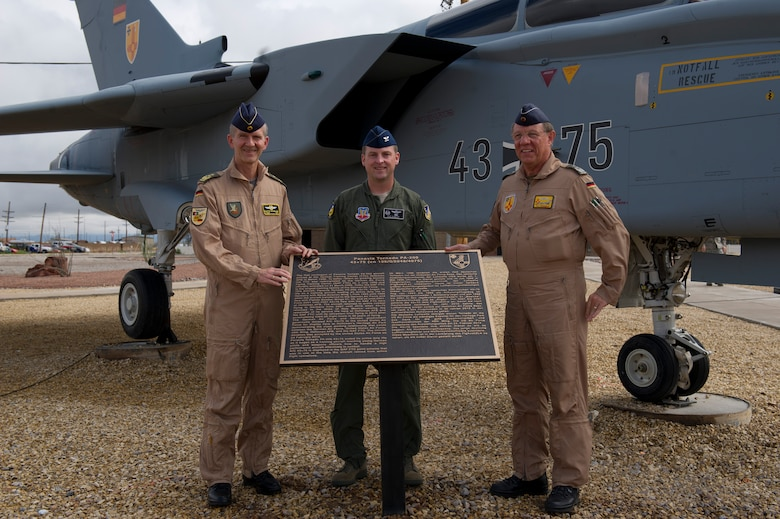 Lieutenant Gen. Martin Schellis, German Operational Forces Command commander, Col. Robert Kiebler, 49th Wing commander, and Col. Heinz Ferkinghoff, German Air Force Flying Training Center commander unveil the Tornado 43+75 plaque at Holloman Air Force Base's Heritage Park Sep. 19. History was made Sep. 19, when a German Air Force static aircraft was unveiled in Heritage Park by Schellis and Kiebler. The GAF Training Center and the Tornados are a significant part of military aviation operations in and around Holloman Air Force Base and White Sands Missile Range. (U.S. photo by Staff Sgt. E'Lysia Wray/ Released)