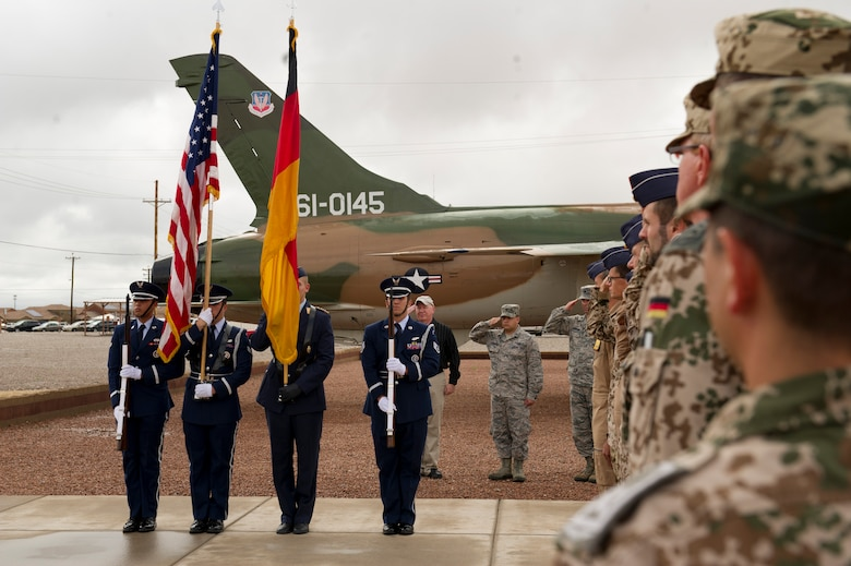 Holloman Air Force Base's Steel Talons and Luftwaffe Honor Guard present the colors at the unveiling ceremony for the Tornado 43+75 in Heritage Park. History was made Sep. 19, when a German Air Force static aircraft was unveiled in Heritage Park by Lt. Gen. Martin Schellis, German Air Force Operational Forces Command commander, and Col. Robert Kiebler, 49th Wing commander. The GAF Training Center and the Tornados are a significant part of military aviation operations in and around Holloman Air Force Base and White Sands Missile Range. (U.S. photo by Staff Sgt. E'Lysia Wray/ Released)