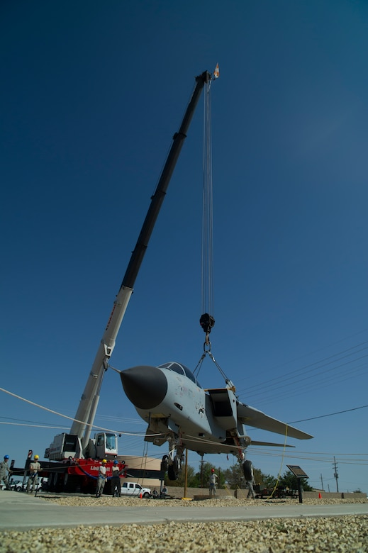 Members of the 49th Maintenance Group crash recovery team hoist a German Air Force Tornado onto it's final resting place at Heritage Park among other historical aircraft that have been flown at Holloman Air Force Base, N.M., July 19. History was made Sep. 19, when a German Air Force static aircraft was unveiled in Heritage Park by Lt. Gen. Martin Schellis, GAF Flying Training Center commander, and Col. Robert Kiebler, 49th Wing commander. The GAF Training Center and the Tornados are a significant part of military aviation operations in and around Holloman Air Force Base and the White Sands Missile Range. (U.S. photo by Airman 1st Class Aaron Montoya / Released)