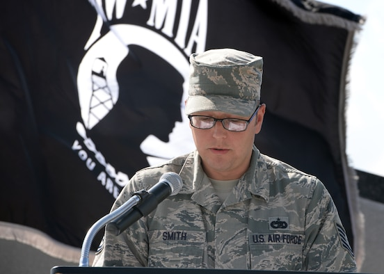 ALTUS AIR FORCE BASE, Okla. – U.S. Air Force Tech. Sgt. Jason Smith, 97th Logistics Readiness Squadron air transportation craftsman, reads a script during a Prisoners of War/Missing in Action Recognition Day retreat ceremony at the Wings of Freedom Park, Sept. 19, 2014. The ceremony was conducted in honor of National POW/MIA Recognition Day, which is observed on the third Friday of September. (U.S. Air Force photo by Senior Airman Franklin R. Ramos/Released)