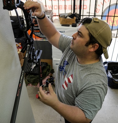 U.S. Air Force Staff Sgt. Seth Pena, a former tactical control air party member now assigned to the 59th Medical Wing's Airman Medical Transition Unit, mounts a scope to his compound bow at a local archery facility in San Antonio Sept. 12, 2014. Pena was severely injured March 2013 when a drunk driver ran a red light, crashing into his motorcycle.  (U.S. Air Force photo/Senior Airman Michael Ellis)