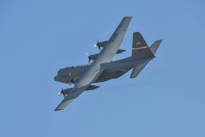 A Kentucky Air National Guard C-130 banks over Groesbeek, Netherlands, Sept. 18, 2014, after deploying U.S., British, Dutch and Polish paratroopers as part of the 70th-anniversary re-enactment of Operation Market Garden. The historic World War II mission was, at the time, the largest airborne assault ever conducted. (U.S. Air National Guard photo by Master Sgt. Charles Delano)