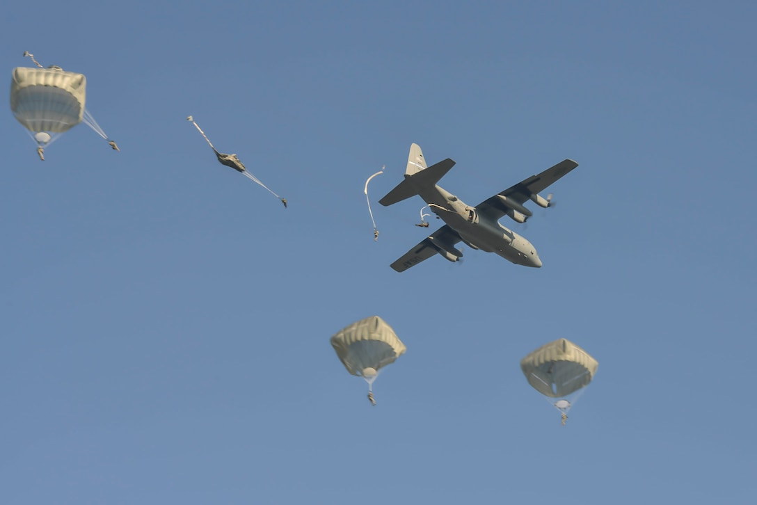 U.S., British, Dutch and Polish troops parachute from a Kentucky Air National Guard C-130 near Groesbeek, Netherlands, Sept. 18, 2014, as part of the 70th-anniversary re-enactment of Operation Market Garden. The historic World War II mission was, at the time, the largest airborne assault ever conducted. (U.S. Air National Guard photo by Master Sgt. Charles Delano)
