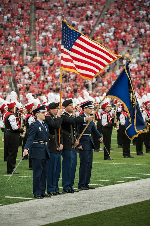 The University of Louisville honors servicemembers during the U of L-Murray State football game at Papa John's Cardinal Stadium in Louisville, Ky., Sept. 6, 2014. The game, billed as Military Appreciation Day, started with a coin toss executed by Air Force Brig. Gen. Warren Hurst, the Kentucky National Guard's assistant adjutant general for Air and commander of the Kentucky Air National Guard. Recruiters from the Kentucky Army and Air Guard also set up booths featuring displays of military equipment and answered questions posed by hundreds of fans. (U.S. Air National Guard photo by Maj. Dale Greer/Released)