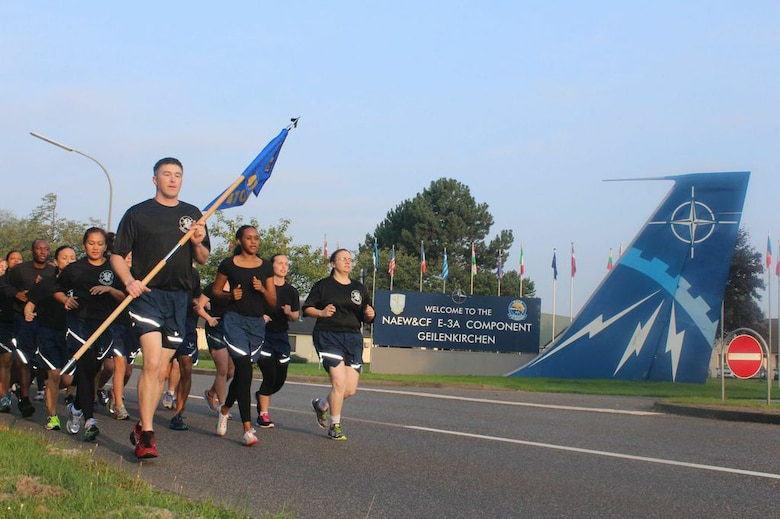 Service members from the 470th Air Base Squadron, Geilenkirchen, Germany, participate in a morale run during a squadron sports day Sept. 12, 2014. Service members from the unit took part in various sporting events including basketball, volleyball, racquetball, football and kickball. (Courtesy photo by U.S. Air Force Staff Sgt. Andrew Caber/Released)