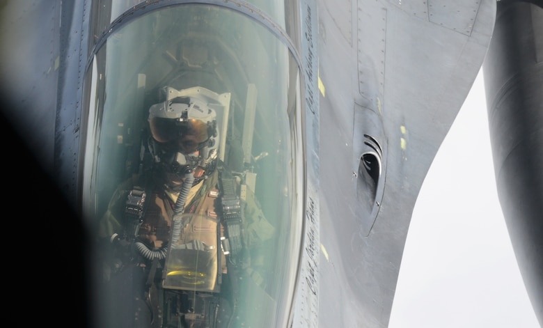 A U.S. Air Force F-16 Fighting Falcon fighter aircraft pilot from the 52nd Fighter Wing closes in on a U.S. Air Force KC-135 Stratotanker to receive fuel during an aerial refueling mission at Spangdahlem Air Base, Germany, Sept. 18, 2014. The F-16 flies within 30 feet of the KC-135 during the refueling process. (U.S. Air Force photo by Airman 1st Class Luke J. Kitterman/Released)