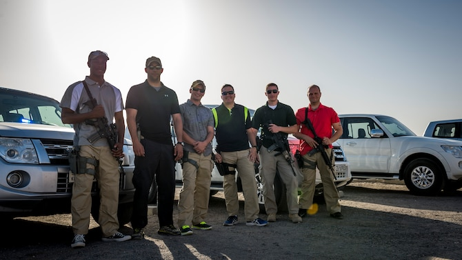 Airmen from the 386th Expeditionary Security Forces security escort team pose after a mission Aug. 6, 2014 at an undisclosed location in Southwest Asia. (U.S. Air Force photo by Staff Sgt. Jeremy Bowcock)