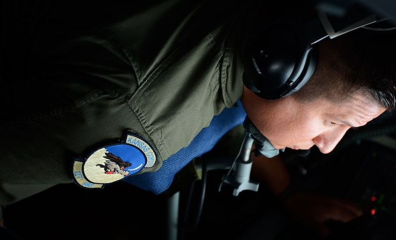 U.S. Air Force Tech. Sgt. Ben Tressler, an in-flight refueling specialist from the 117th Air Refueling Squadron based out of Topeka, Kan., operates the boom of a U.S. Air Force KC-135 Stratotanker during an aerial refueling mission at Spangdahlem Air Base, Sept. 18, 2014.Tressler hails from Yates Center, Kan., and has been to 29 countries in his career. (U.S. Air Force photo by Airman 1st Class Luke J. Kitterman/Released)