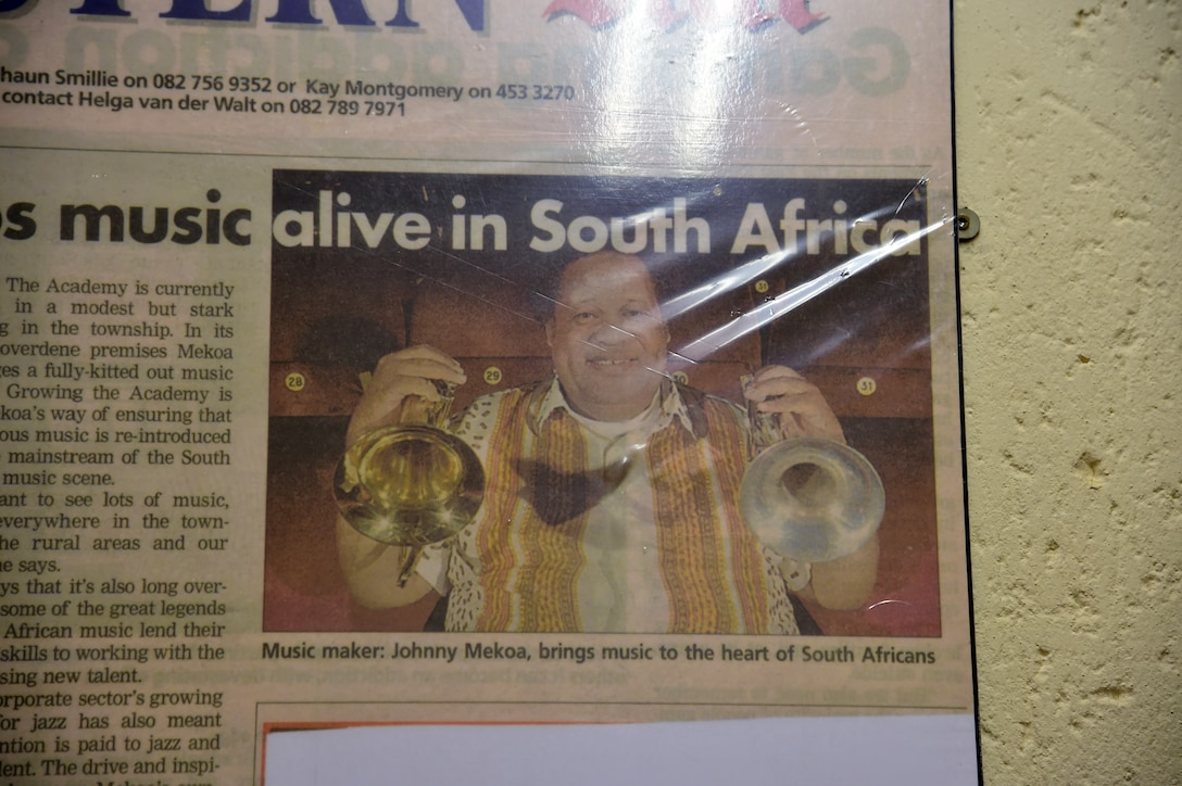 A news clipping of founder and director of the Music Academy of Gauteng in Benoni, South Africa, Sept. 18, 2014 Johnny Mekoa. Mekoa is a renowned trumpeter in South Africa and teaches young students how to love and appreciate music. (U.S. Air Force photo/Staff Sgt. Travis Edwards-Released)