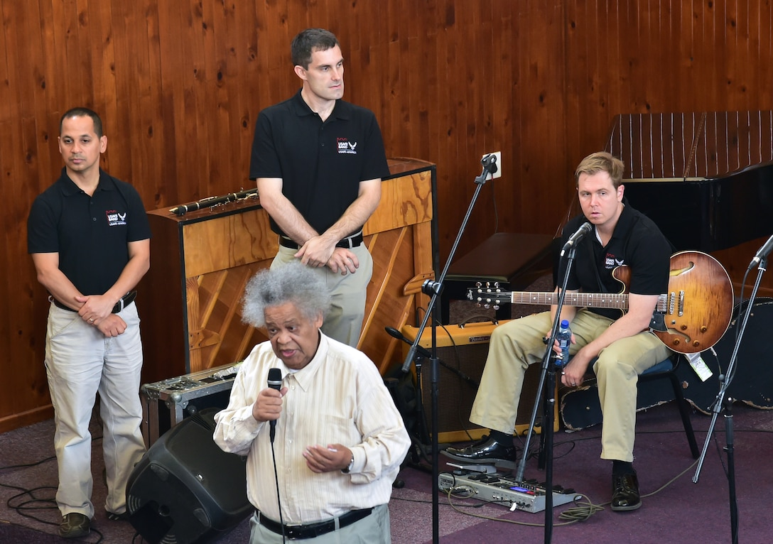 Johnny Mekoa (front), founder and director of the Music Academy of Gauteng in Benoni, South Africa gives opening remarks prior to the U.S. Air Forces in Europe jazz band, Wings of Dixie, breaking off into four separate working groups teach their respective musical skills Sept 18, 2014. In addition to teaching the musical workshop, the jazz band played a free, live concert for nearly 150 music students.  (U.S. Air Force photo/Staff Sgt. Travis Edwards-Released)