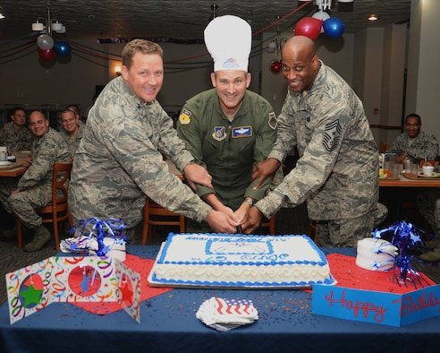Brig. Gen Andrew Toth, 36th Wing commander, Col. Tyrell Chamberlain, 36th Wg vice commander and Chief Master Sgt. Michael McMillan, 36 Wg command chief,  cuts a cake during the 67th Air Force birthday celebration at the Top of The Rock dining facility Sept. 18, 2014, on Andersen Air Force Base, Guam. The cake cutting celebrates the creation of the U.S. Air Force as an independent service in 1947, when the Air Force separated from the U.S. Army. (U.S. Air Force photo by Senior Airman Cierra Presentado/Released)