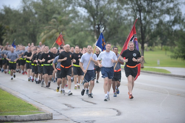 Brig. Gen. Andrew J. Toth,  36th Wing commander ,(left) and Lt. Col. Clyde Cochrane, U.S. Army Task Force Talon commander, lead the Task Force Talon 5K Sept 10, 2014, on Andersen Air Force Base, Guam. The Task Force Talon 5K was a joint physical training session. (U.S. Air Force photo by Airman 1st Class Adarius Petty/Released)