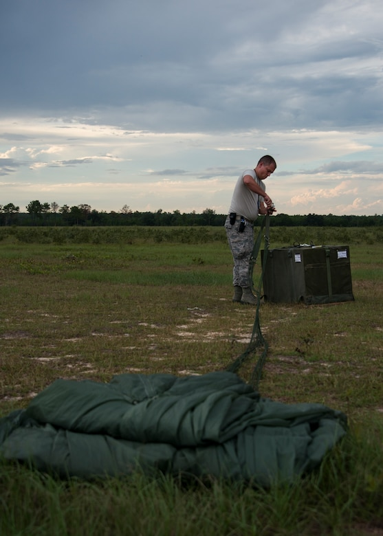 Senior Airman Kelby Ramer detaches the parachute from the low cost low altitude bundles during a training mission Sept. 15, at Duke Field, Fla.  The Airmen of the SOLRS prepare and load an average of 24 to 48 loads per week to help train pilots and loadmasters from the 5th, 6th, and the 711th Special Operations Squadron. (Air Force photo/Tech. Sgt. Jasmin Taylor)