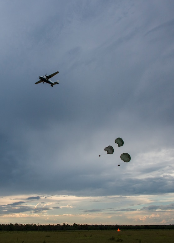 A C-145 Skytruck dropped three low cost low altitude bundles during a training mission Sept. 15, at Duke Field, Fla.  The Airmen of the SOLRS prepare and load an average of 24 to 48 loads per week to help train pilots and loadmasters from the 5th, 6th, and the 711th Special Operations Squadron. (Air Force photo/Tech. Sgt. Jasmin Taylor)