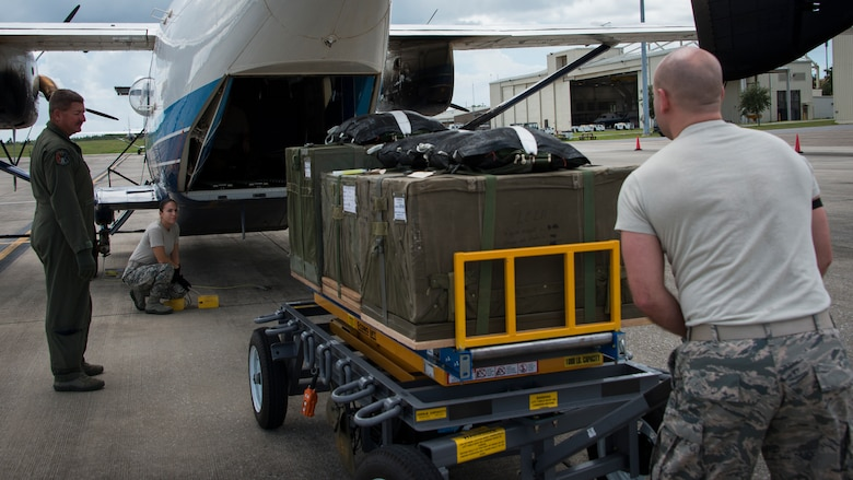 Members from the 919th Special Operations Logistics Readiness Squadron, load three low cost low altitude airdrop bundles into a C-145 Sept. 15, at Duke Field, Fla. The Airmen of the SOLRS prepare and load an average of 24 to 48 loads per week to help train pilots and loadmasters from the 5th, 6th, and the 711th Special Operations Squadron. (Air Force photo/Tech. Sgt. Jasmin Taylor)