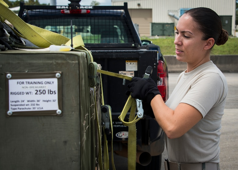 Senior Airmen Melissa Derkatz, 919th Special Operations Logistics Readiness Squadron, loads three low cost low altitude airdrop bundles into a C-145 Sept. 15, at Duke Field, Fla. The Airmen of the SOLRS prepare and load an average of 24 to 48 loads per week to help train pilots and loadmasters from the 5th, 6th, and the 711th Special Operations Squadron. (Air Force photo/Tech. Sgt. Jasmin Taylor)