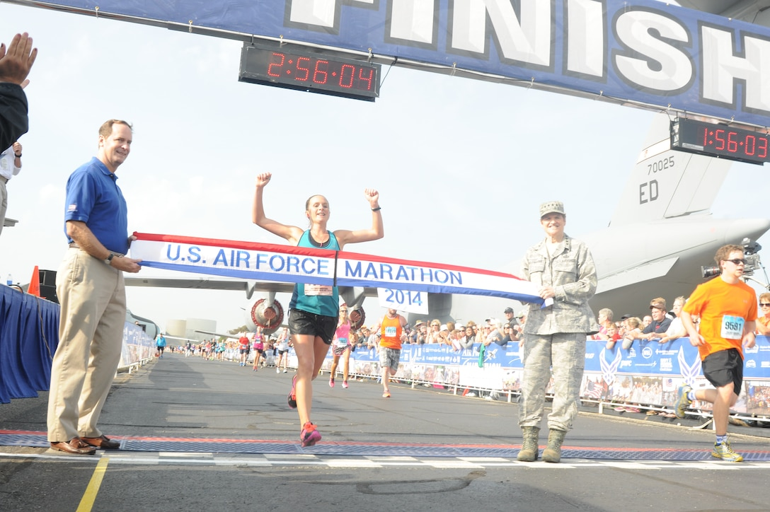 Nicoloa Holdsworth crosses the finish line and is the winner of the 2014 U.S. Air Force Marathon's women's full marathon Sept. 20, 2014, at Wright-Patterson Air Force Base, Ohio. This was Holdworth's first marathon win. (U.S. Air Force photo/Wes Farnsworth)
