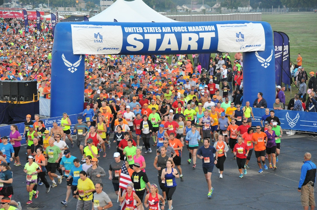 Runners take off from the starting line of the 2104 U.S. Air Force Marathon Sept. 20, 2014, at Wright-Patterson Air Force Base, Ohio. The race set an attendance record with approximately 15,000 runners. (U.S. Air Force photo/Mike Libecap)
