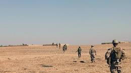 Marines and sailors with Bravo Company, 1st Battalion, 2nd Marine Regiment, patrol with Afghan National Army counterparts during a security operation in Helmand province, Sept. 9, 2014. During the 72-hour operation, Marines and ANA soldiers conducted dismounted patrols on foot to search nearby compounds for weapons and lethal aid. (U.S. Marine Corps photo by Cpl. Cody Haas/ Released)