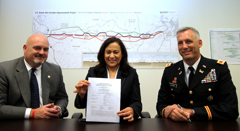 Commissioner Charlie Kilpatrick, Virginia Department of Transportation, Irene Rico, U.S. Department of Transportation Federal Highway Administration division administrator, and Col. Paul Olsen, commander of U.S. Army Corps of Engineers' Norfolk District signed the U.S. Route 460 draft Supplemental Environmental Impact Statement, Sept. 18, in Suffolk, Va. The public comment period for the draft SEIS ends Nov. 17.