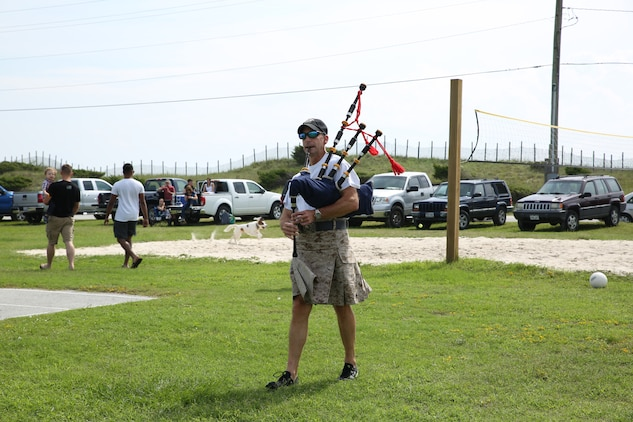 Col. Matthew G. St. Clair, commanding officer, Ground Combat Element Integrated Task Force, plays his bagpipes during the unit's beach bash family event at Onslow Beach. Sept. 19, 2014. The bash served as the unit's first family event. From October 2014 to July 2015, the Ground Combat Element Integrated Task Force will conduct individual and collective skills training in designated combat arms occupational specialties in order to facilitate the standards based assessment of the physical performance of Marines in a simulated operating environment performing specific ground combat arms tasks. (U.S. Marine Corps photo by Cpl. Paul S. Martinez/Released)