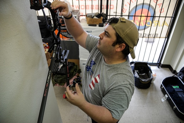 Staff Sgt. Seth Pena mounts a scope to his compound bow Sept. 14, 2014, at a local archery facility in San Antonio. Pena is vying for a spot on the Air Force team competing at the 2014 Warrior Games, taking place from Sept. 28 to Oct. 4, in Colorado Springs, Colorado. Pena is a former tactical control air party member and is now assigned to the 59th Medical Wing's Airman Medical Transition Unit. (U.S. Air Force photo/Senior Airman Michael Ellis)