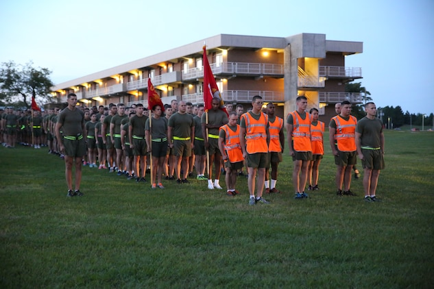 Marines and sailors with the Ground Combat Element Integrated Task Force prepare to step off on their unit run aboard Marine Corps Base Camp Lejeune, North Carolina, Sept. 19, 2014. The run was in celebration of the uncasing of the units organizational colors. The task force ran three miles, calling cadence and showcasing guidons along the way. From October 2014 to July 2015, the Ground Combat Element Integrated Task Force will conduct individual and collective skills training in designated combat arms occupational specialties in order to facilitate the standards based assessment of the physical performance of Marines in a simulated operating environment performing specific ground combat arms tasks. (U.S. Marine Corps photo by Cpl. Paul S. Martinez/Released)