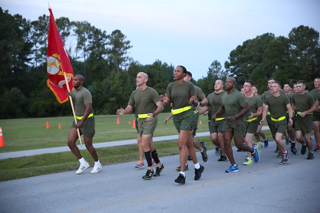 Col. Matthew G. St. Clair, center-front, commanding officer, Ground Combat Element Integrated Task Force, and Sgt. Maj. Robin C. Fortner, sergeant major, GCEITF, lead a unit run aboard Marine Corps Base Camp Lejeune, North Carolina, Sept. 19, 2014. The run was in celebration of the uncasing of the units organizational colors.  From October 2014 to July 2015, the Ground Combat Element Integrated Task Force will conduct individual and collective skills training in designated combat arms occupational specialties in order to facilitate the standards based assessment of the physical performance of Marines in a simulated operating environment performing specific ground combat arms tasks. (U.S. Marine Corps photo by Cpl. Paul S. Martinez/Released)