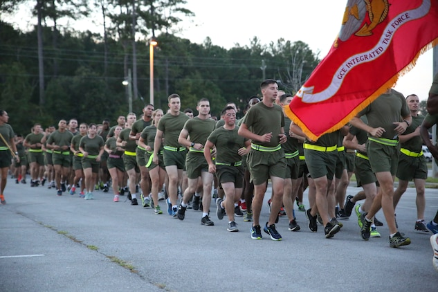 Marines and sailors with the Ground Combat Element Integrated Task Force run aboard Marine Corps Base Camp Lejeune, North Carolina, Sept. 19, 2014. The run was led by Col. Matthew G. St. Clair, commanding officer, GCEITF, and Sgt. Maj. Robin C. Fortner, sergeant major, GCEITF. The run was in celebration of the uncasing of the units organizational colors. From October 2014 to July 2015, the Ground Combat Element Integrated Task Force will conduct individual and collective skills training in designated combat arms occupational specialties in order to facilitate the standards based assessment of the physical performance of Marines in a simulated operating environment performing specific ground combat arms tasks. (U.S. Marine Corps photo by Cpl. Paul S. Martinez/Released)
