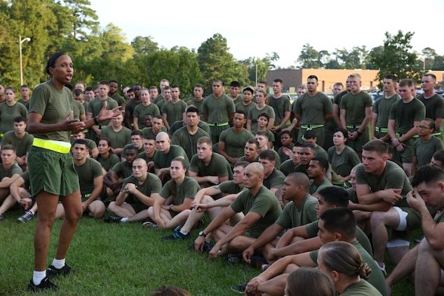 Sgt. Maj. Robin C. Fortner, sergeant major, Ground Combat Element Integrated Task Force, addresses Marines and sailors after a unit run aboard Marine Corps Base Camp Lejeune, North Carolina, Sept. 19, 2014. The run served as a celebration of the unit uncasing its organizational colors. From October 2014 to July 2015, the Ground Combat Element Integrated Task Force will conduct individual and collective skills training in designated combat arms occupational specialties in order to facilitate the standards based assessment of the physical performance of Marines in a simulated operating environment performing specific ground combat arms tasks. (U.S. Marine Corps photo by Cpl. Paul S. Martinez/Released)
