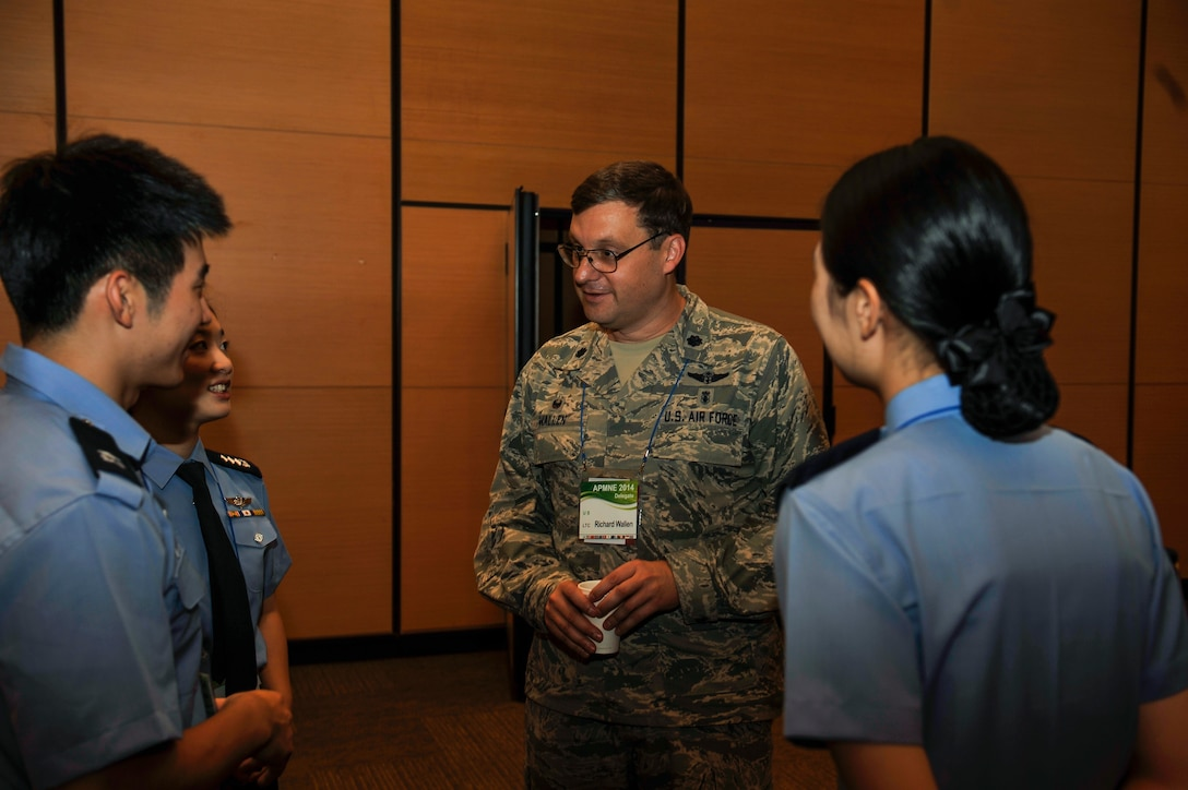 Lt. Col. Richard Wallen, 51st Medical Operations Squadron commander, interacts with nurses of the Republic of Korea air force during the Asia-Pacific Military Nursing Exchange in Daejeon, Republic of Korea Sept. 4, 2014. The APMNE is a multilateral international military nursing engagement. It provides an opportunity for U.S. military nursing leaders to engage with senior military nursing colleagues in the Asia-Pacific region. (U.S. Air Force photo/Senior Airman David Owsianka)
