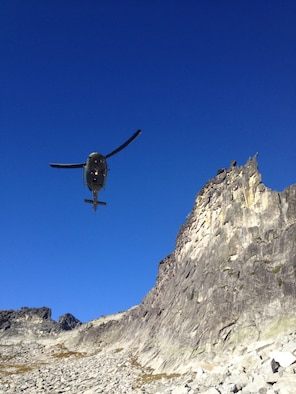Fairchild Air Force Base crewmembers from 'Rescue 13' approach the scene of a rescue mission in their UH-1N Iroquois helicopter near Priest Lake, Idaho, Sept. 20, 2014. A 36-year-old female was entrapped by a 1.5 ton boulder while hiking in the area. The four-man crew extradited the victim out of the area after a ground crew managed to free her from the boulder. (Courtesy photo by Jason Luthy)