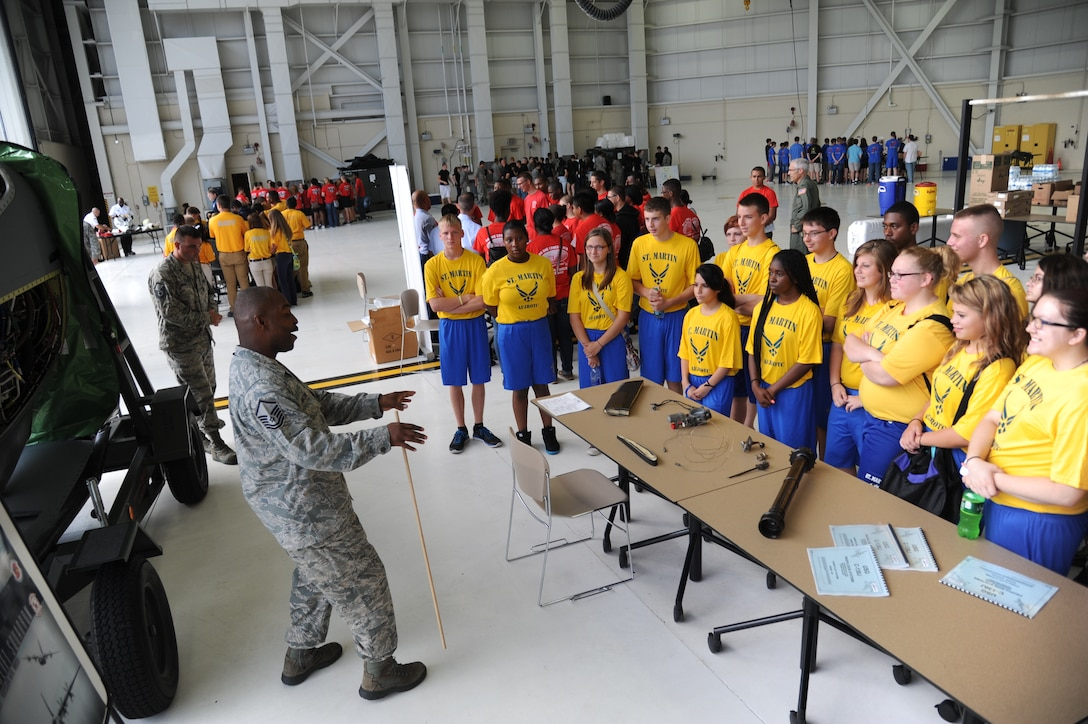 Master Sgt. Donald Maloid, 403rd Maintenance Squadron, briefs on the duties of  the Hurricane Hunters, to St. Martin High School Junior ROTC students during STEM (science, technology, engineering and mathematics) Diversity Outreach Day Sept. 19, 2014, at the fuel cell hangar, Keesler Air Force Base, Miss.  The event consisted of 10 Mississippi gulf coast high school JROTC units visiting informative booths about Air Force opportunities and accession requirements with an emphasis on STEM.  (U.S. Air Force photo by Kemberly Groue)