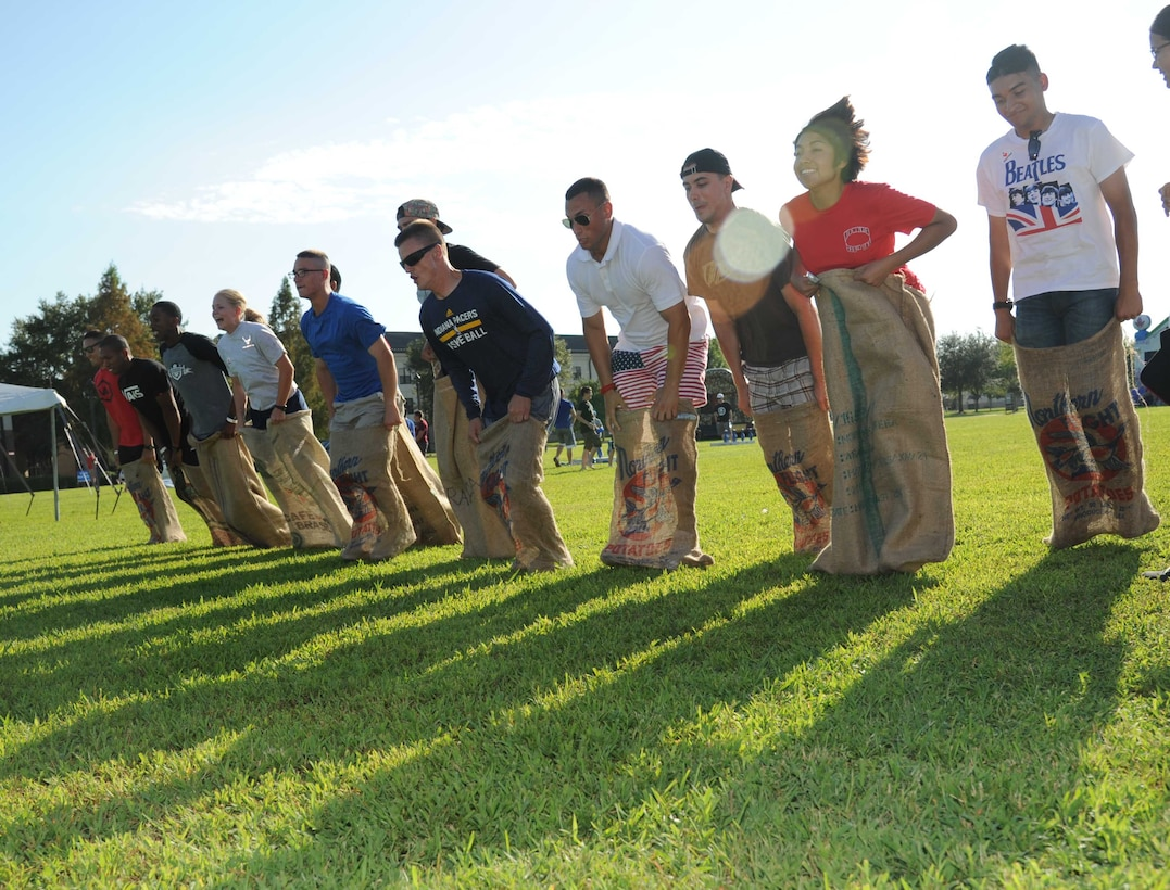 Airmen compete in the potato sack contest during the Air Force's 67th birthday celebration Sept. 19, 2014, Keesler Air Force Base, Miss. The event also included a cake cutting ceremony, music, games, contests and food. (U.S. Air Force photo by Kemberly Groue)