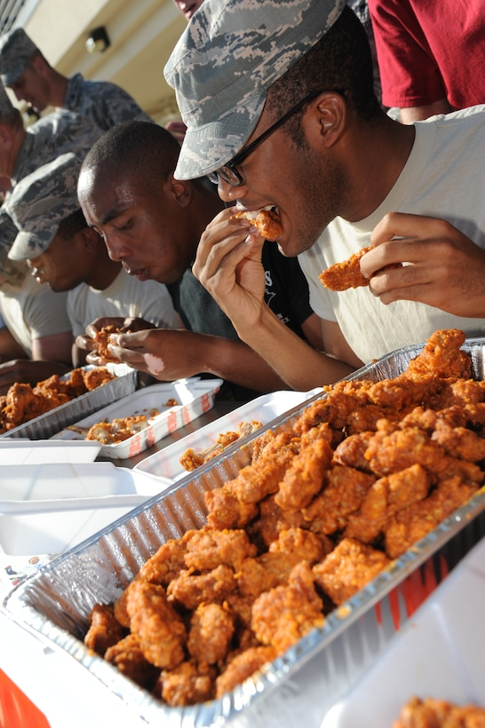 Airman Basic Jeremiah Knowles, 338th Training Squadron, competes in the hot wing eating contest during the Air Force's 67th birthday celebration Sept. 19, 2014, Keesler Air Force Base, Miss. The event also included a cake cutting ceremony, music, games, contests and food. (U.S. Air Force photo by Kemberly Groue)